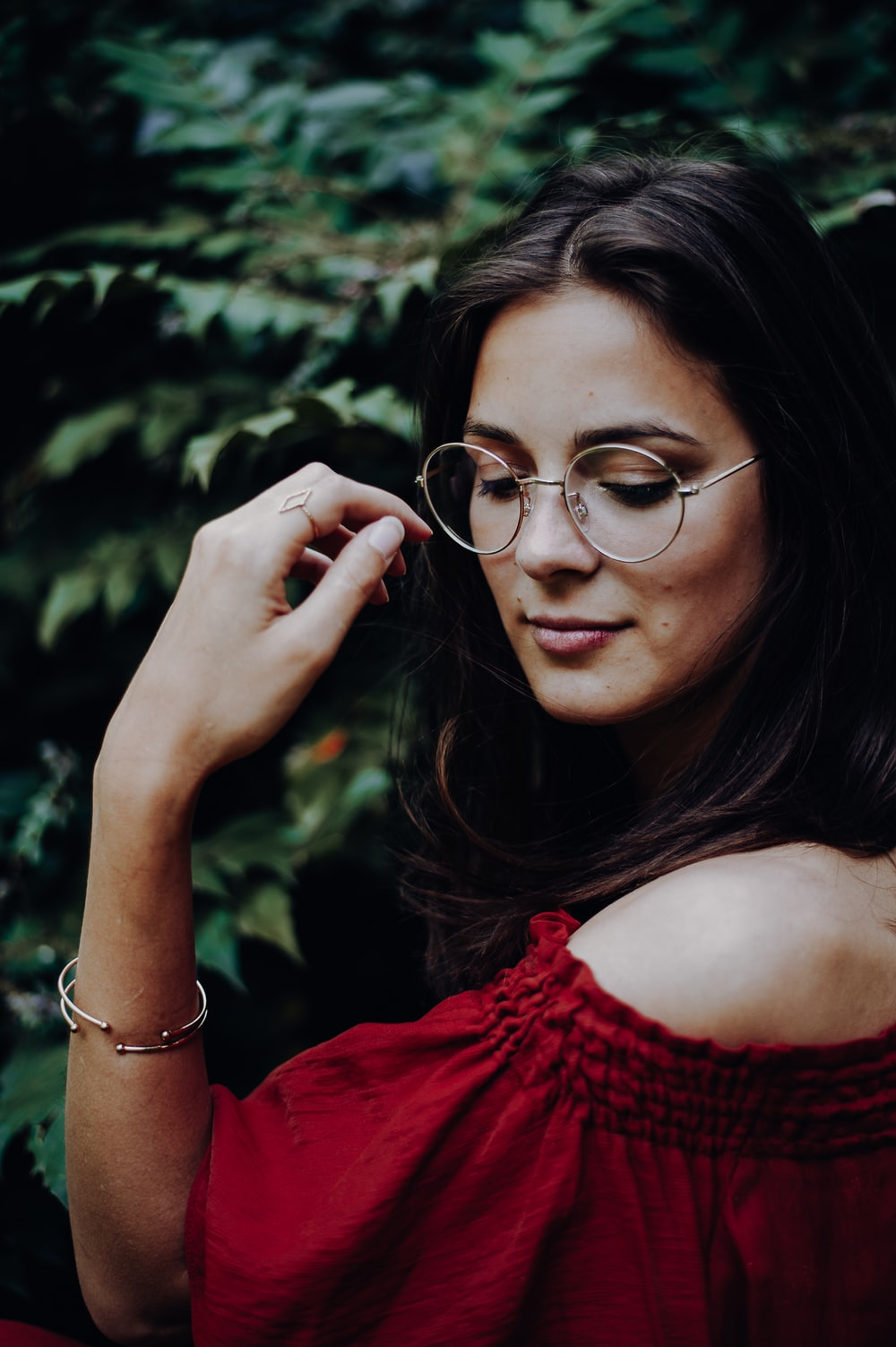 woman wearing red off-shoulder top
