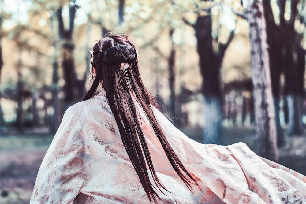 woman wearing kimono facing backward
