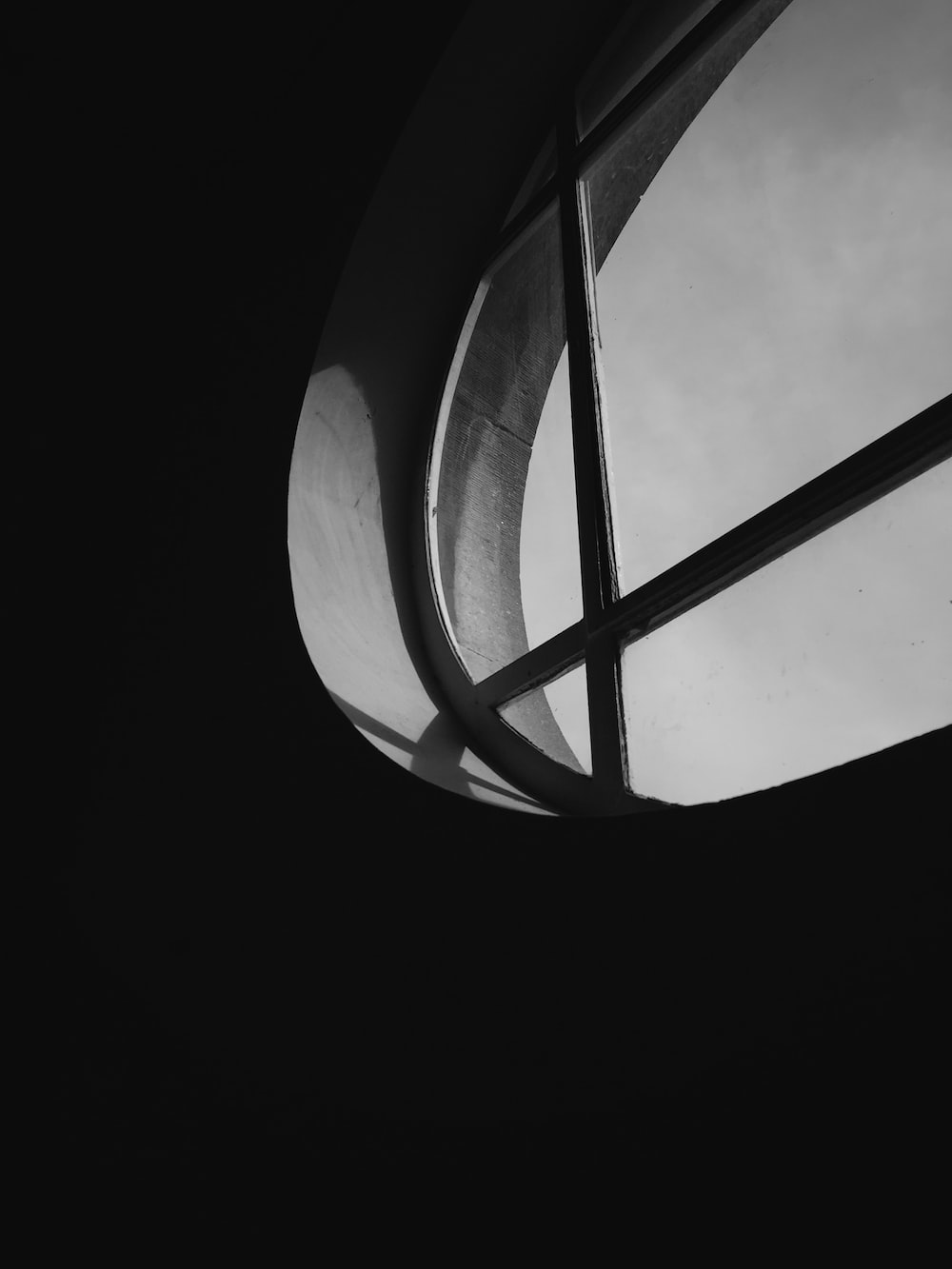 grayscale photography of round clear glass window
