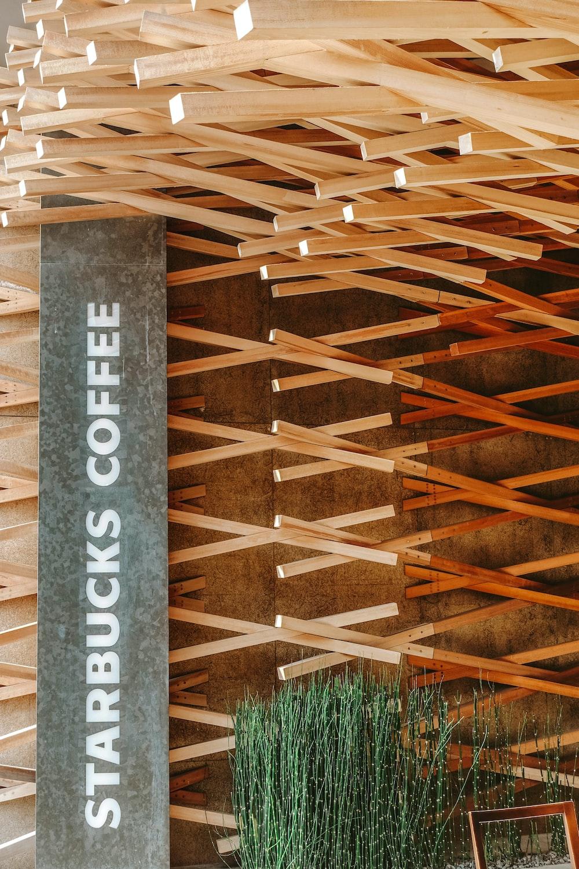 gray and white Starbucks Coffee sign