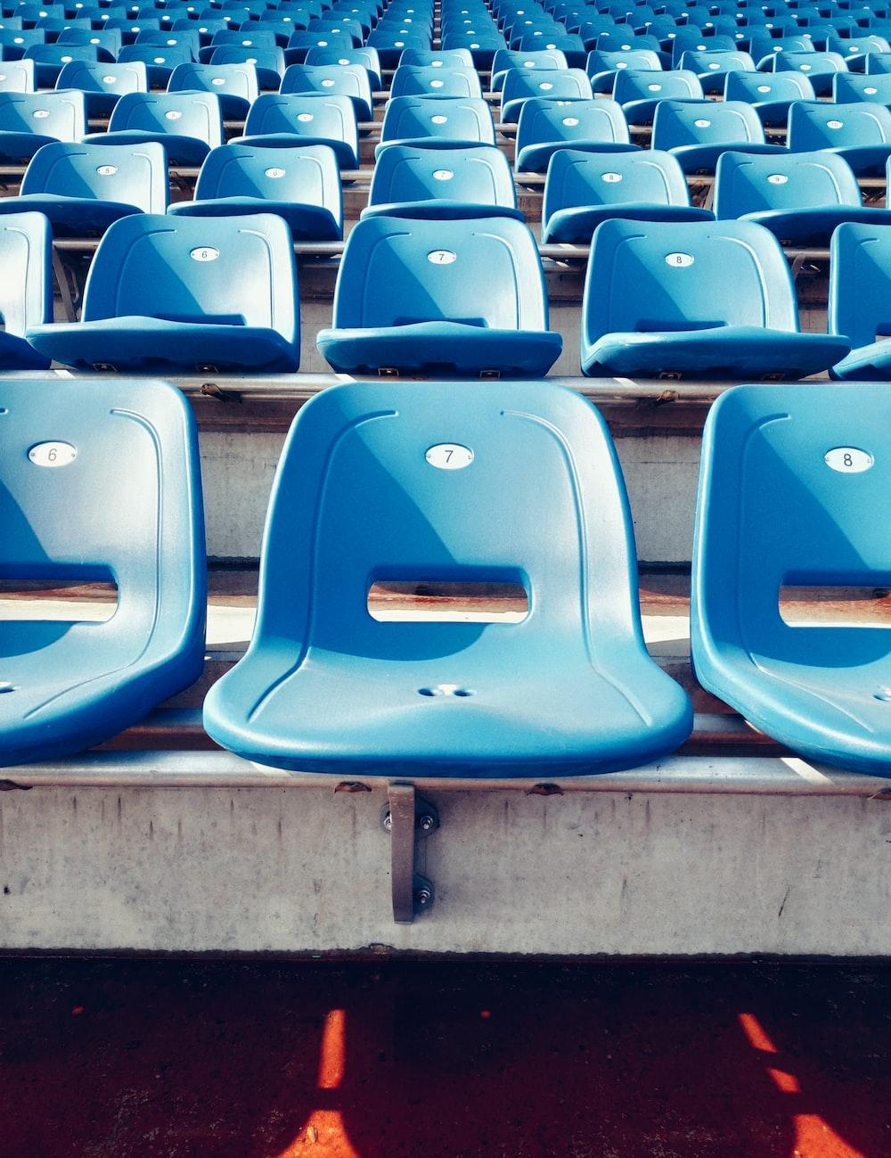 blue plastic chairs at stadium