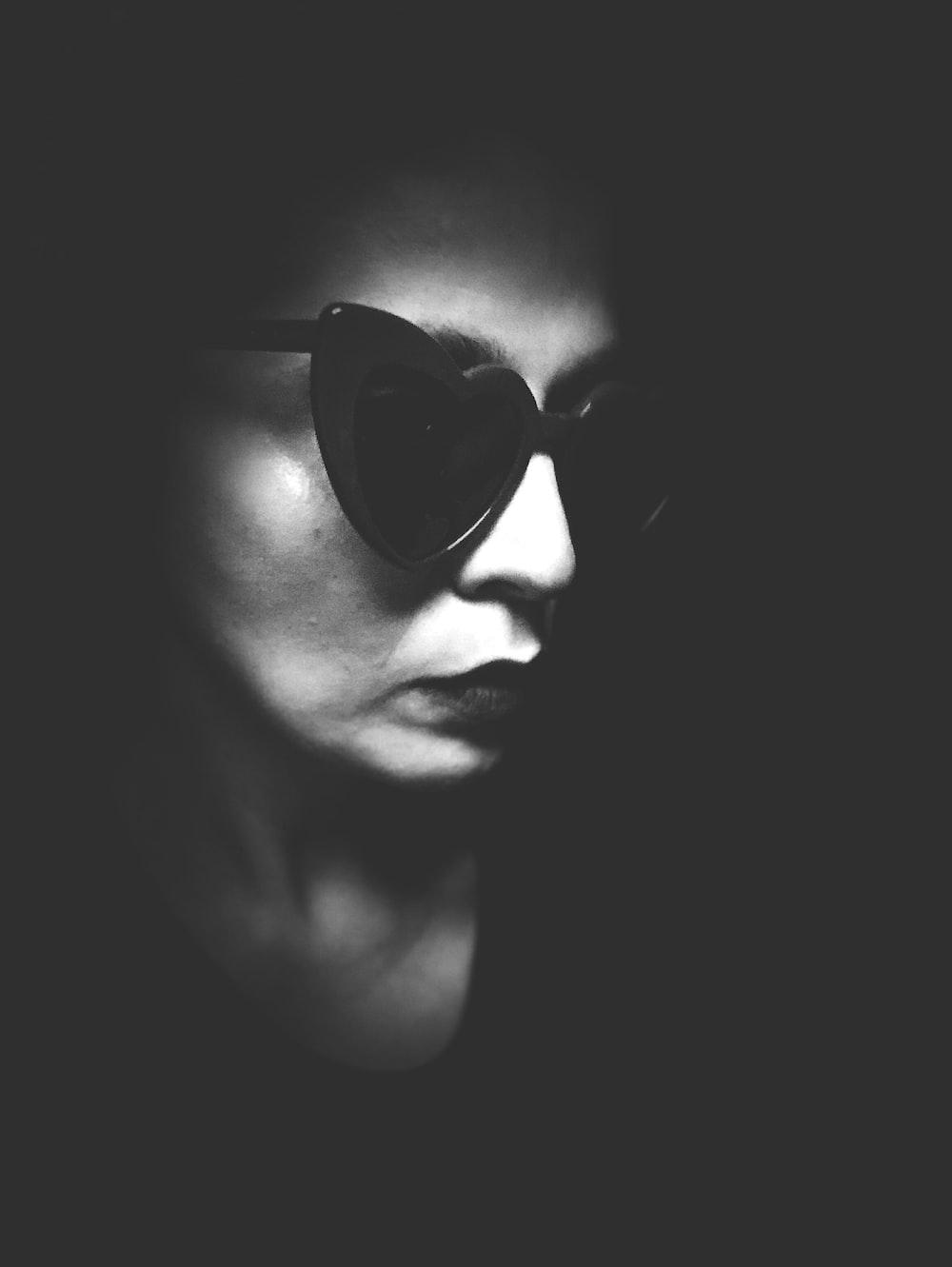 woman wearing black frame sunglasses