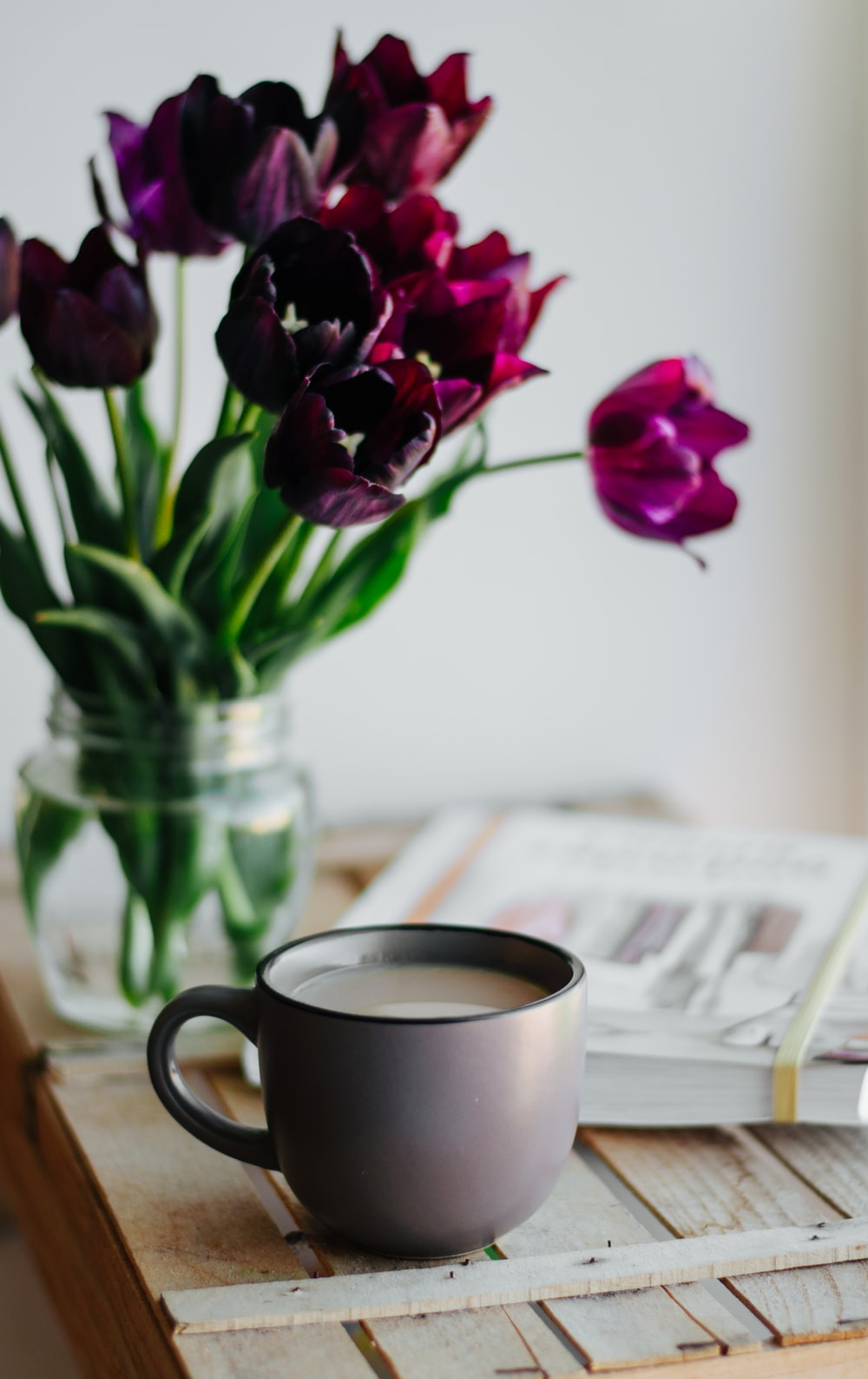 cup near tulip flowers