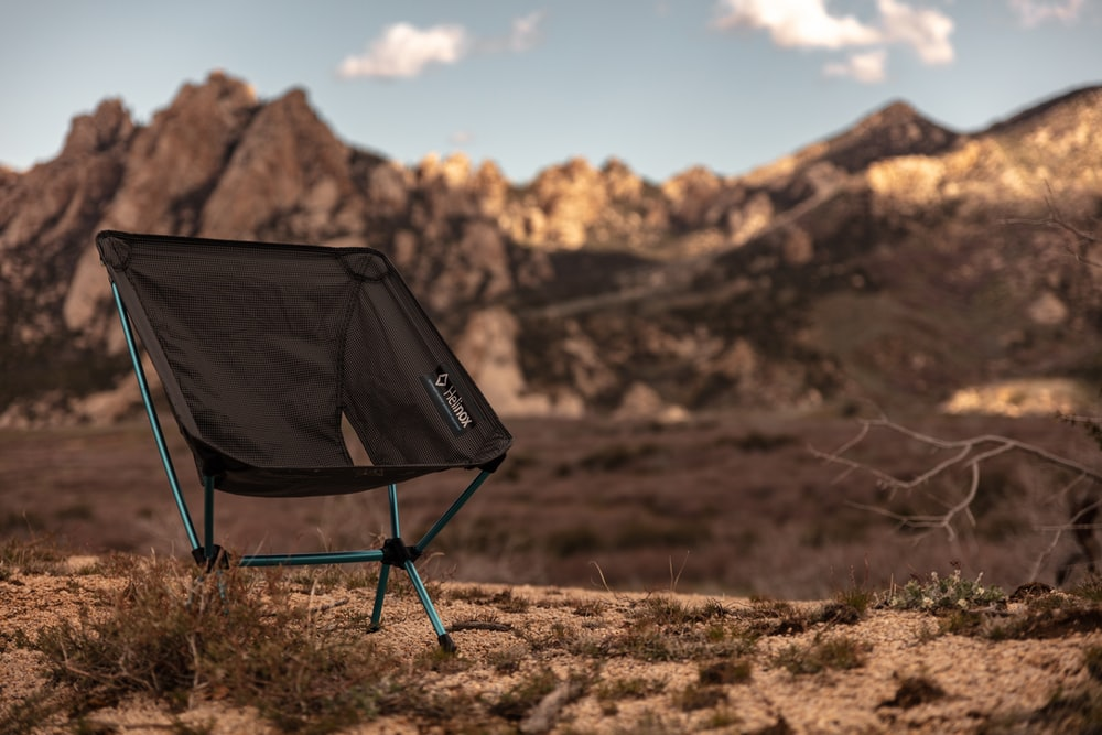 gray and black camper chair during daytime