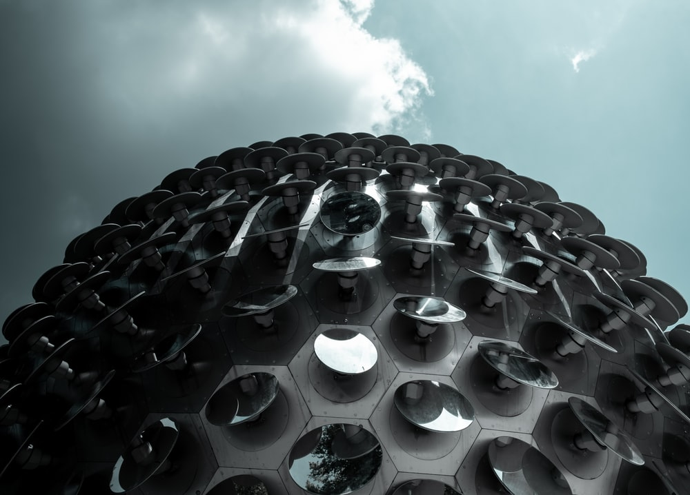low-angle photography of gray dome building under cloudy sky