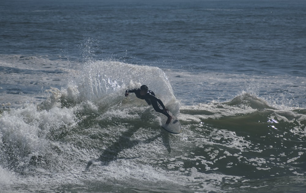 person surfing during day