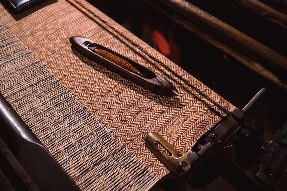 black metal part on brown textile