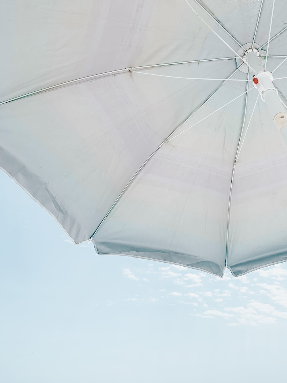 low-angle photography of white parasol