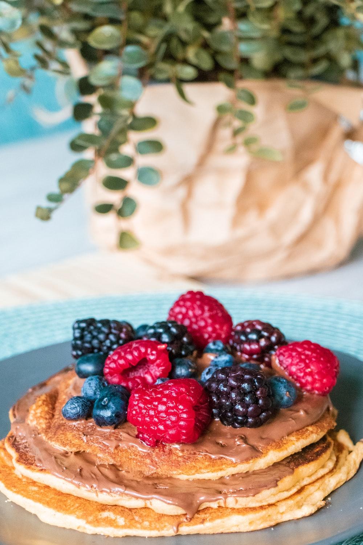 blackberries, raspberries, and blueberries on pancake