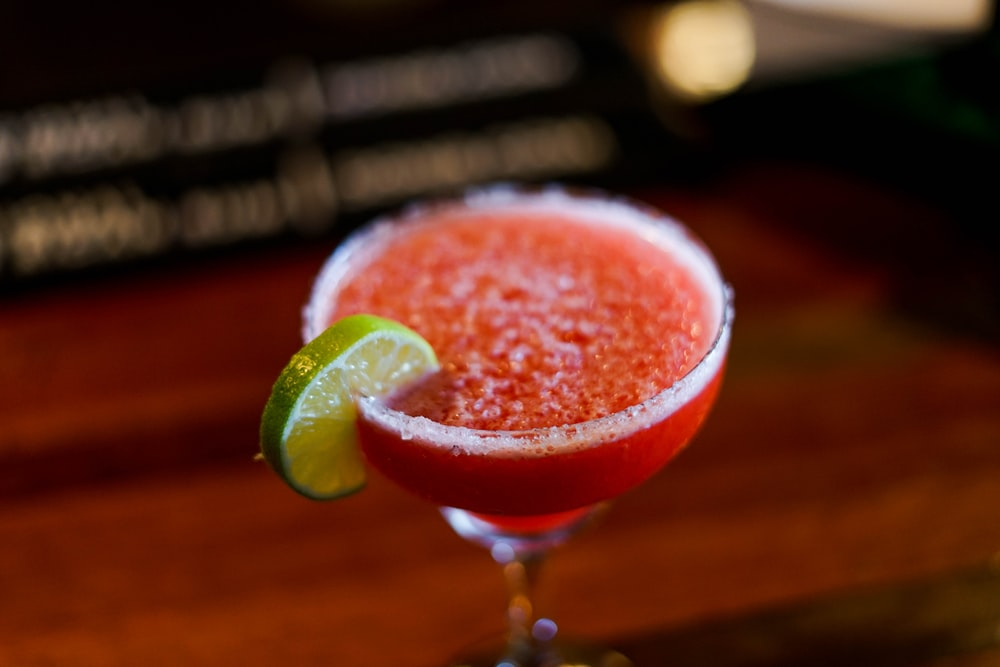 strawberry juice with slice lime on side