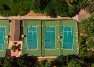 aerial photography of three tennis courts