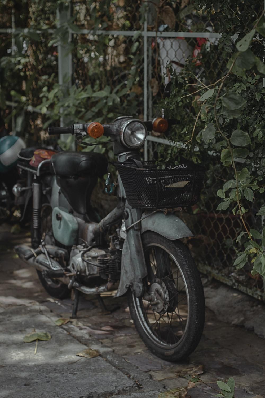 grey classic Honda Cub moped motorcycle