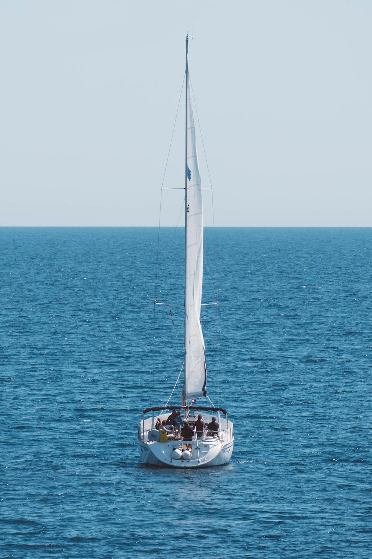 white sailboat at sea