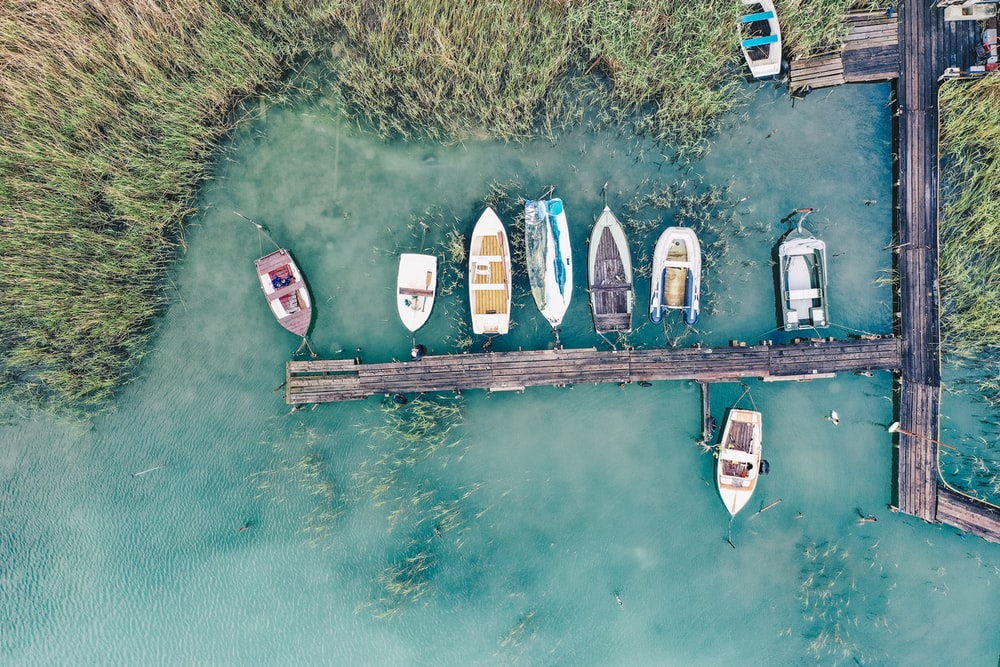 top view of a wooden dock with boats