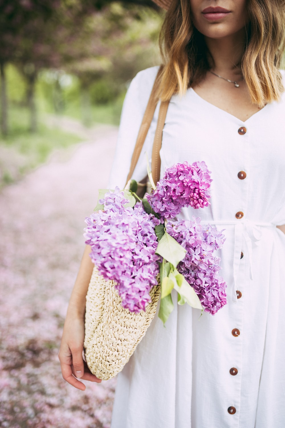 woman carrying bag with flowers