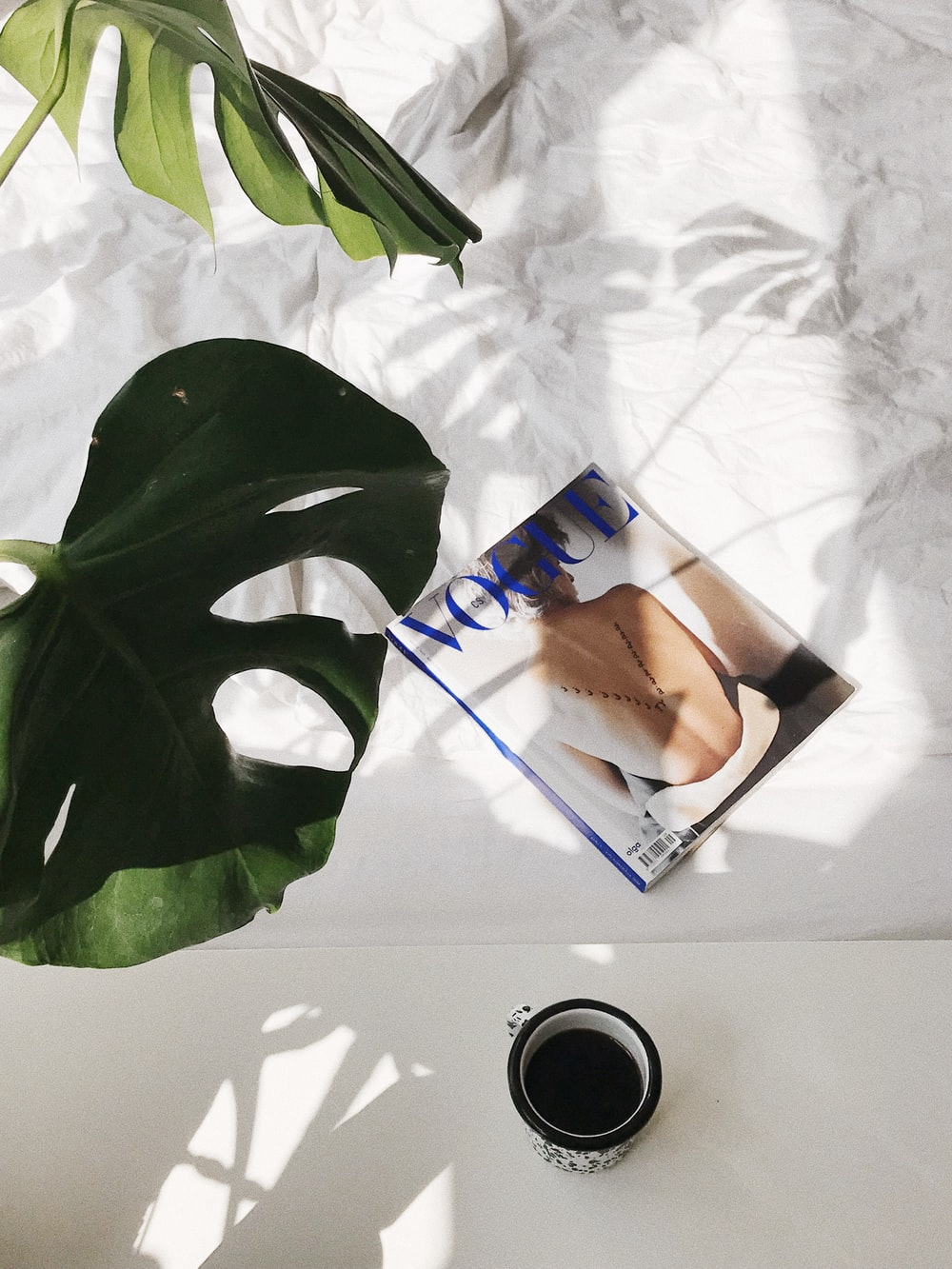 Vogue magazine on bed