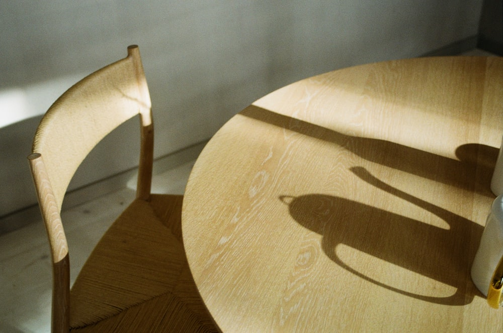 round brown wooden table and brown wooden armless chair