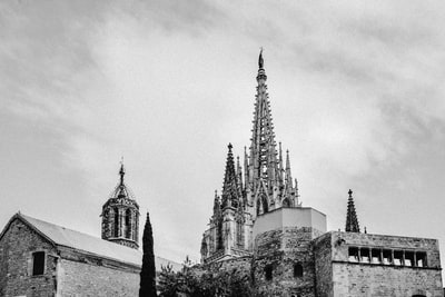grayscale photo of sagrada familia tower teams background