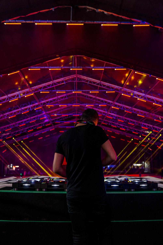DJ facing DJ mixer