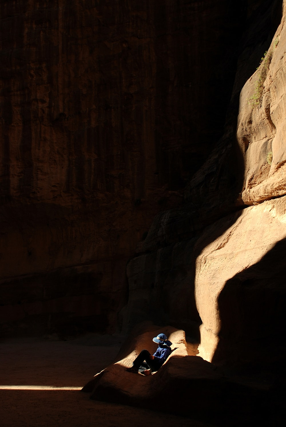 person sitting inside cave