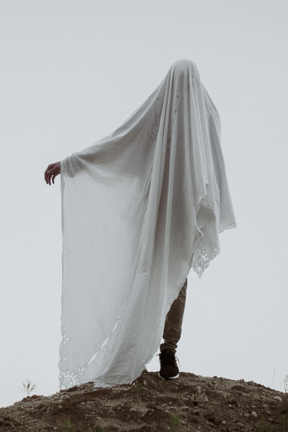 man covered in white cloth