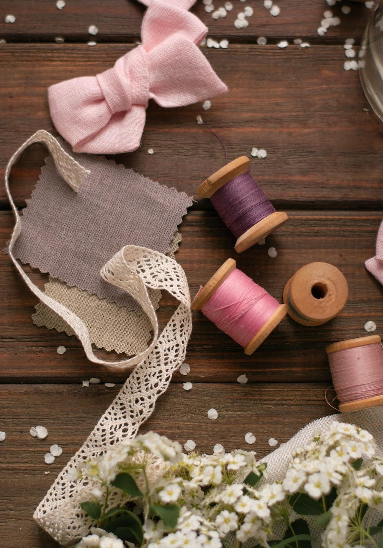 four assorted-color yarn thread spools