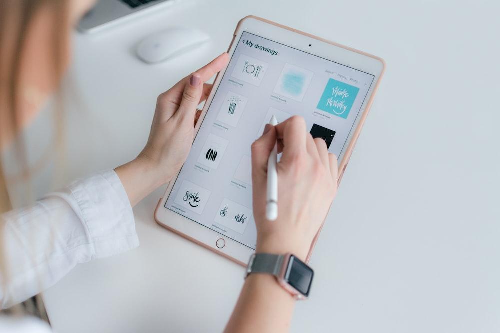 woman using rose gold iPad