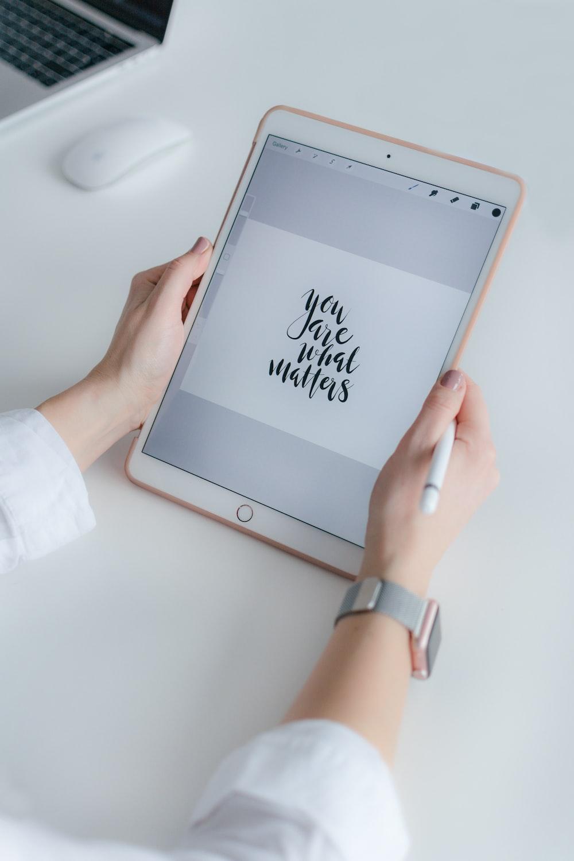 woman using gold iPad