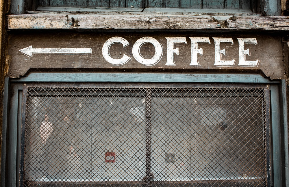 coffee sign pointing at it's right