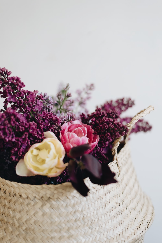 assorted flowers in brown wicker basket