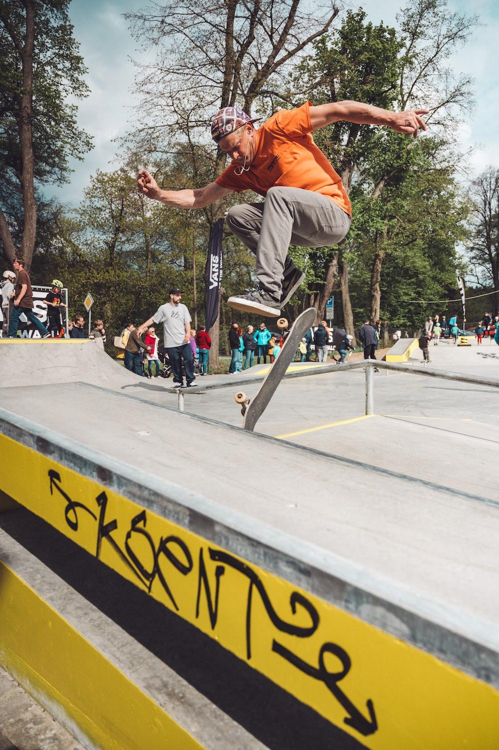 man doing skateboard tricks at the park