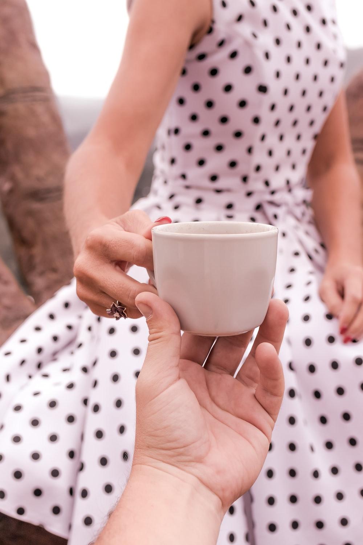 women;s white polka dot dress close-up photography