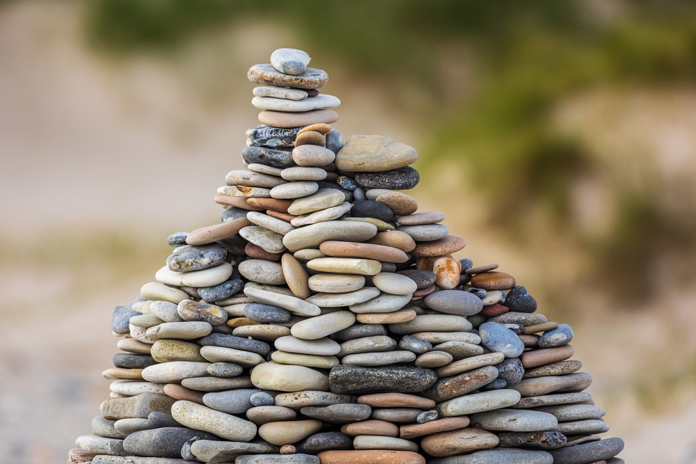 selective focus photography of stack of stones