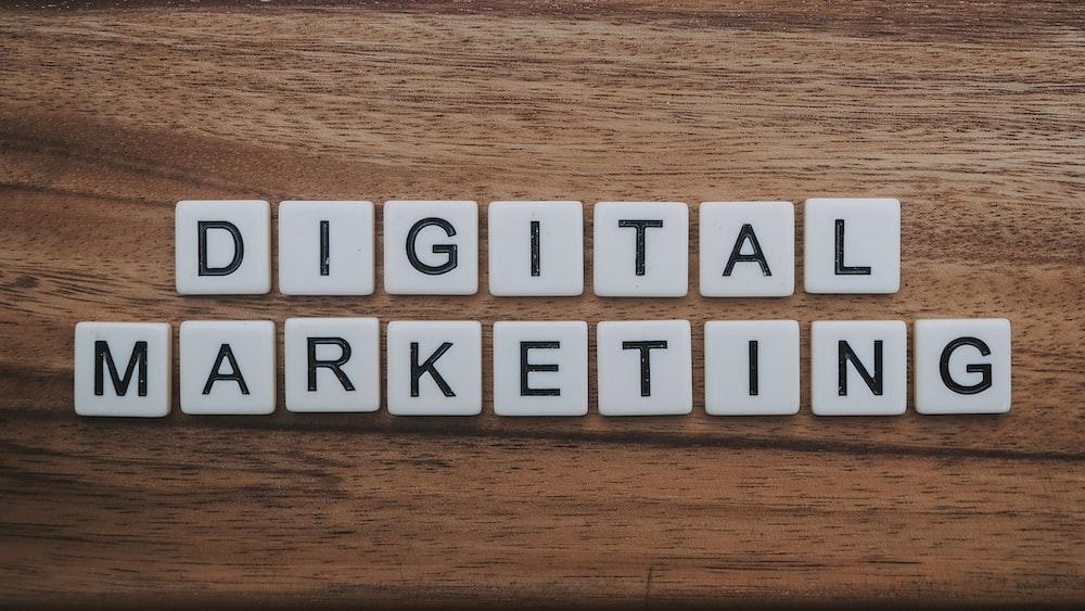 digital marketing artwork on brown wooden surface