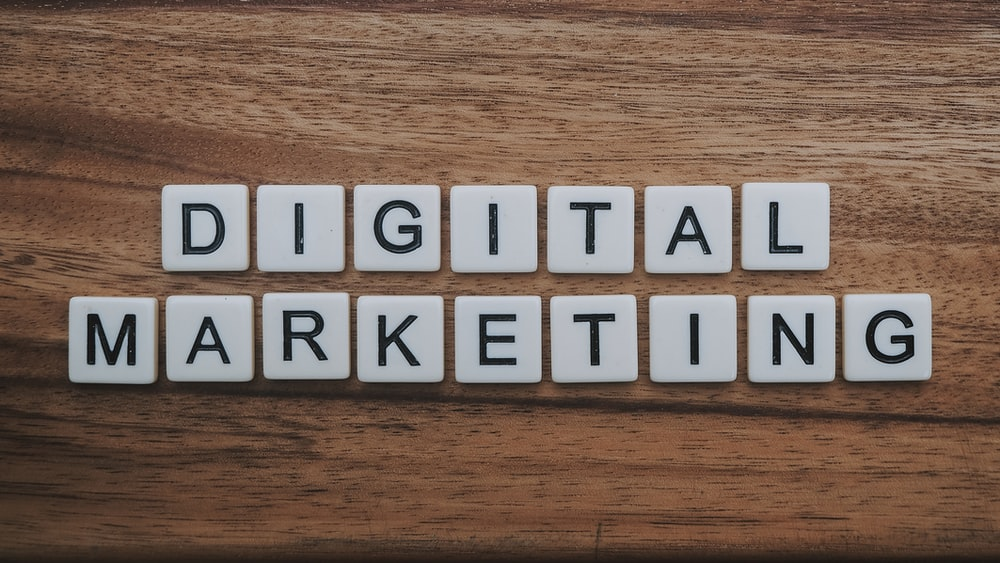 digital marketing artwork on brown wooden surface