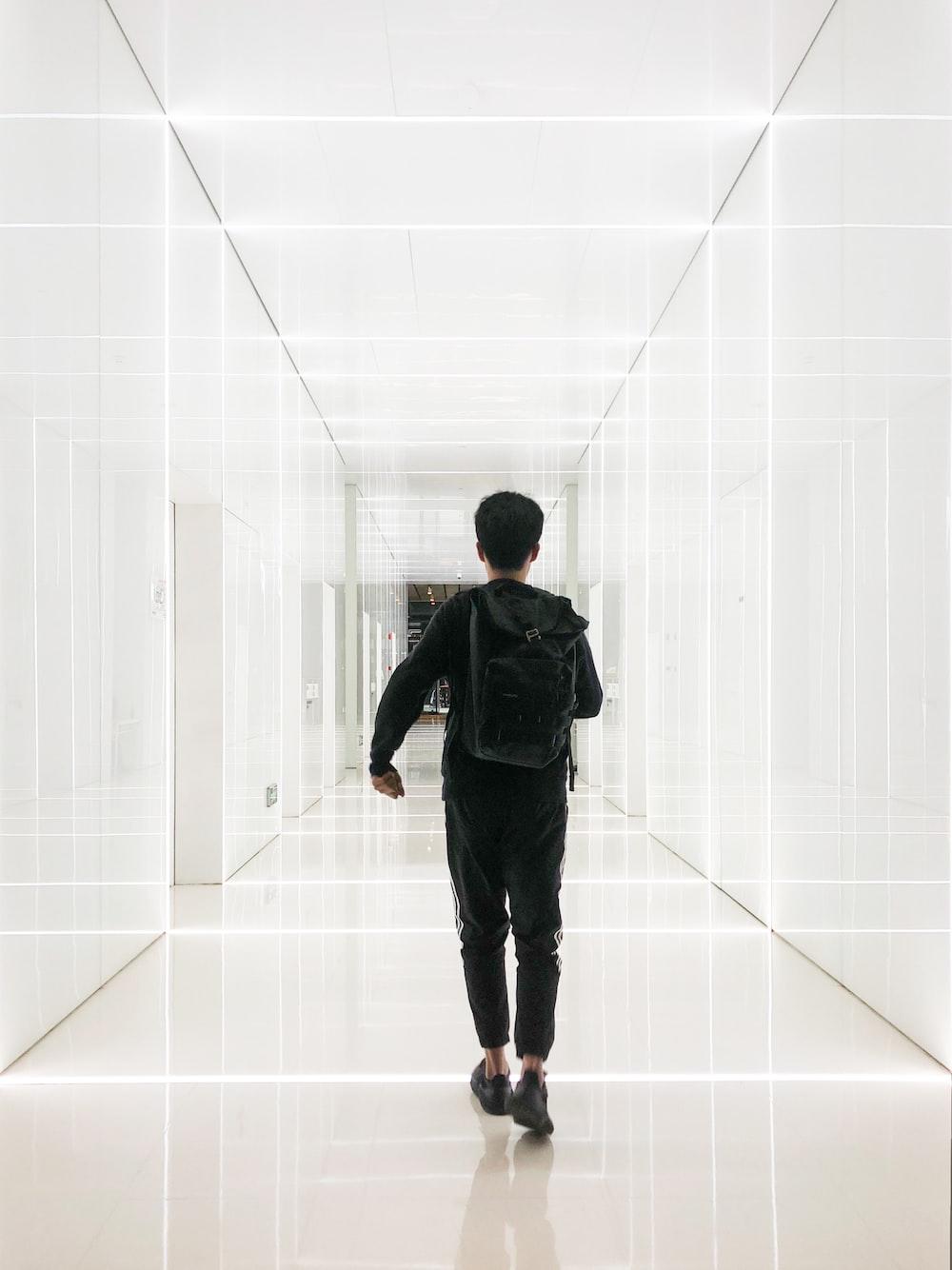boy walking in hallway