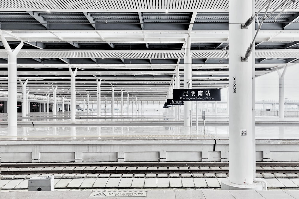 white wall vacant train station during daytime