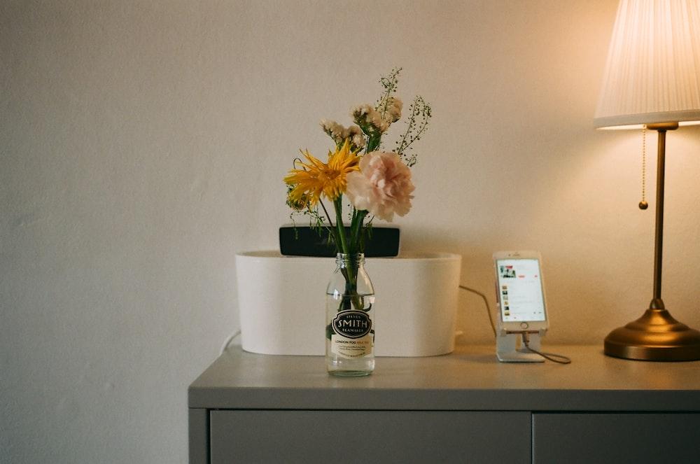 vase of yellow flowers
