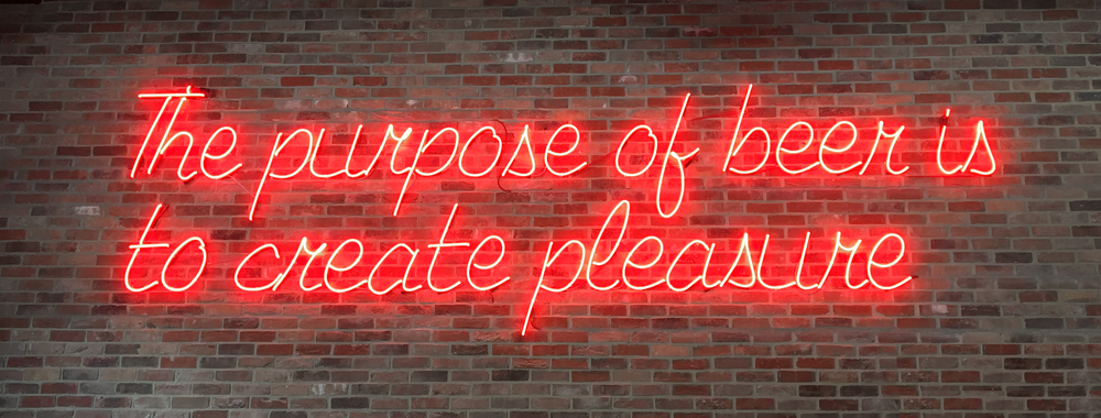 red the purpose of beer is to create pleasure sign