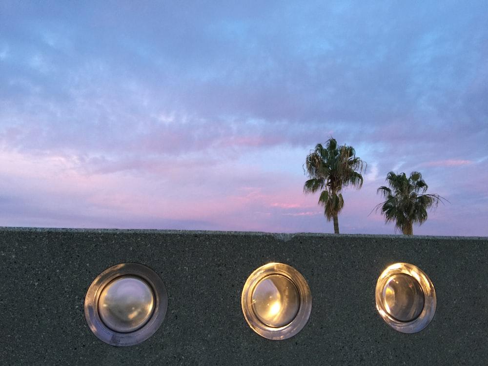 three round glass holes during daytime