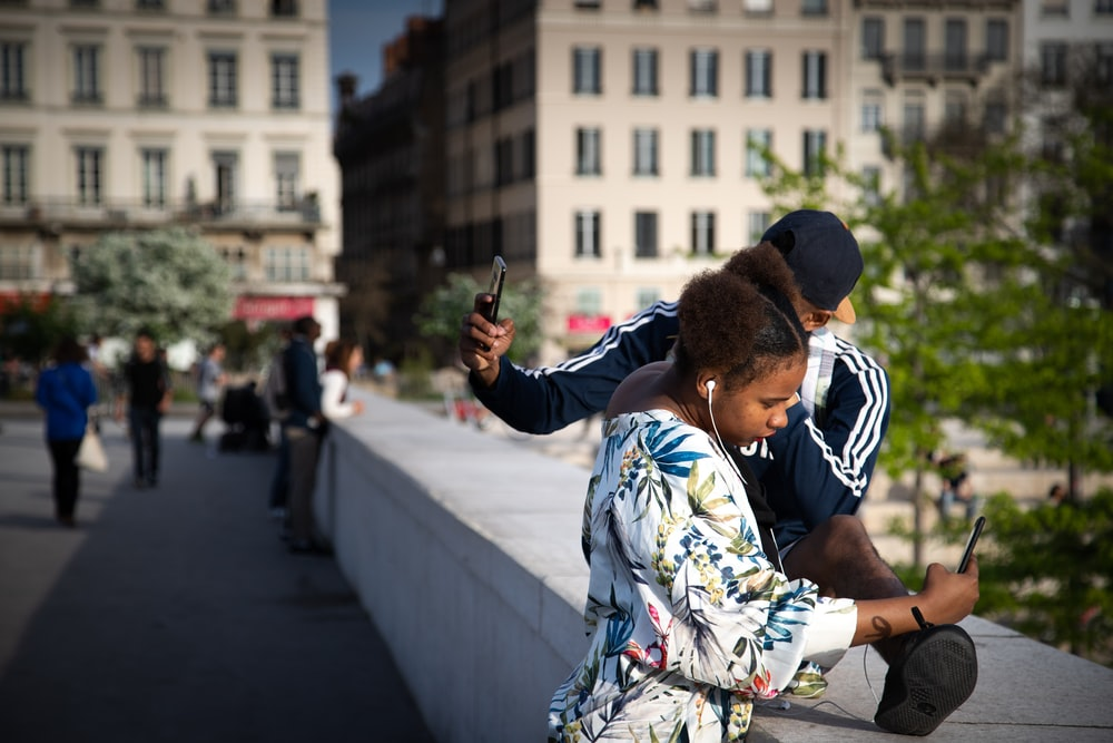 woman and man taking photos
