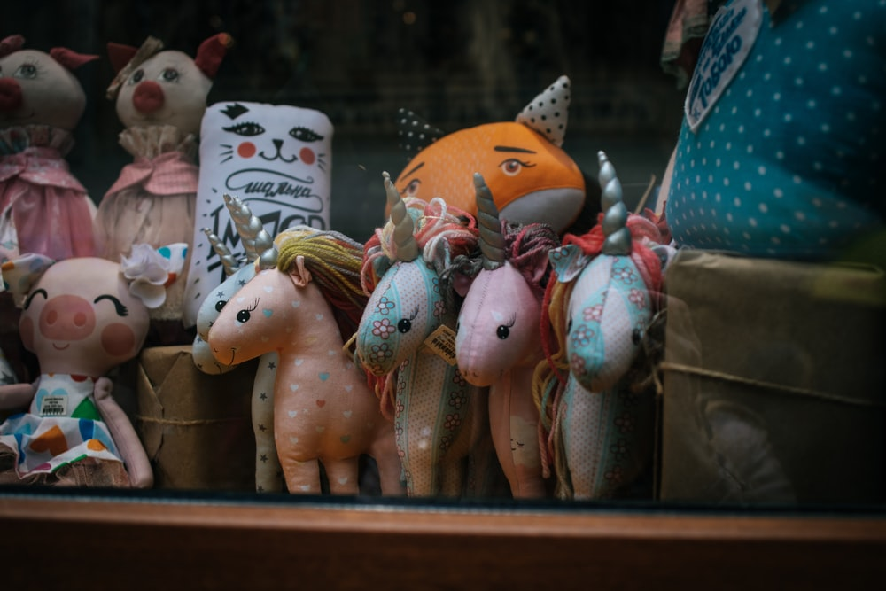 several unicorn plush toys