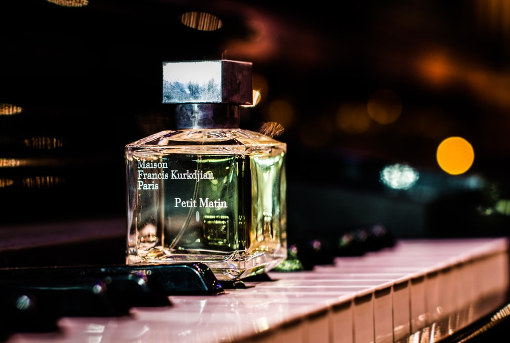 clear fragrance bottle on piano