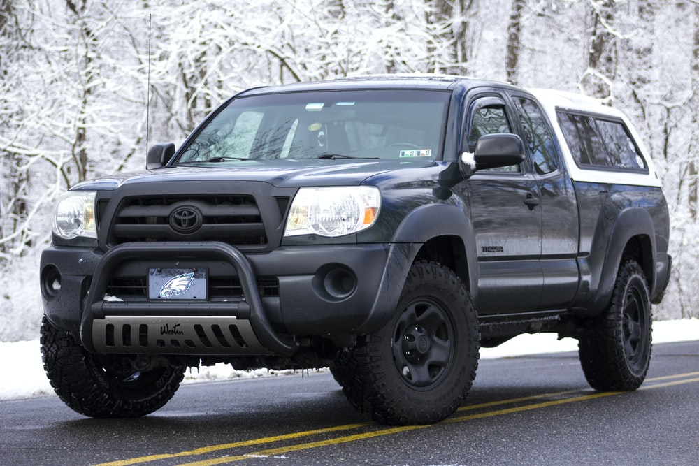 Black Toyota Extended Cab Pickup Truck With Camper Shell