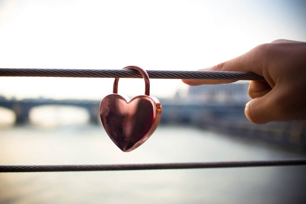 copper heart padlock on cable railings