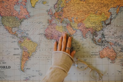 woman touching world map