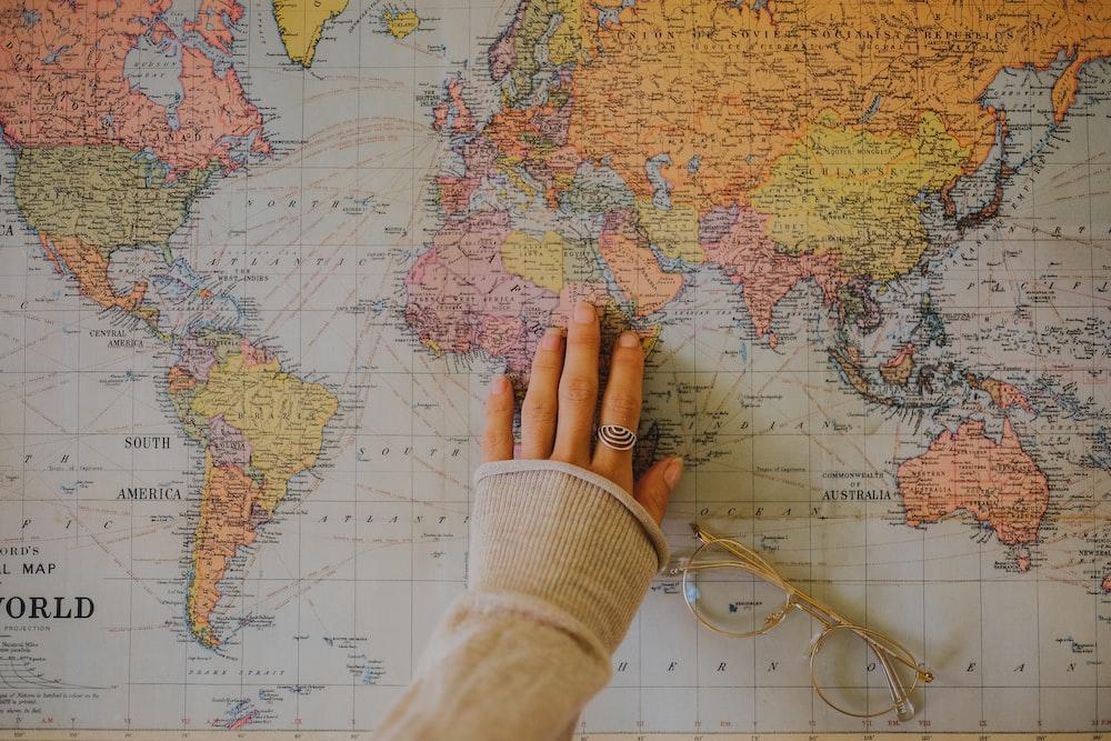 woman touching world map