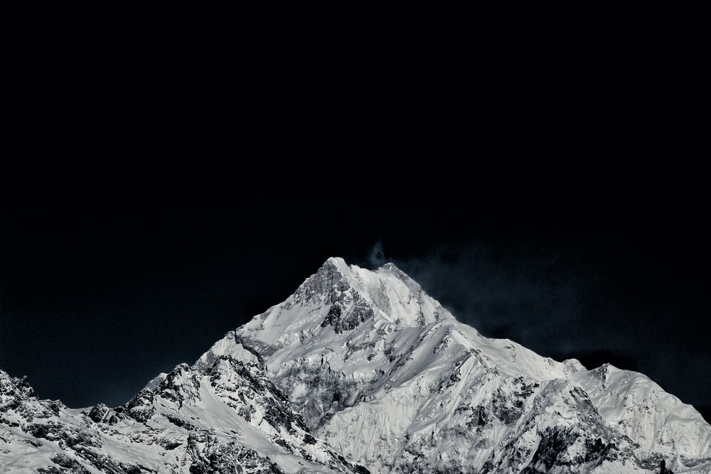 pointed mountain filled with snow