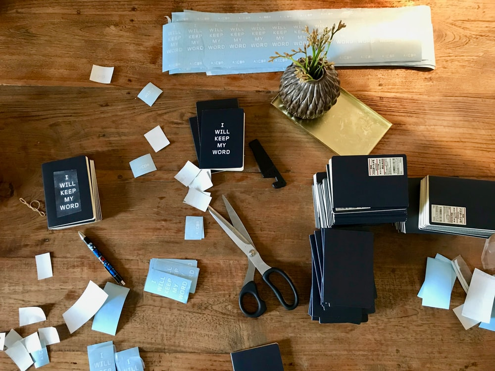 books, papers, and items on brown surface