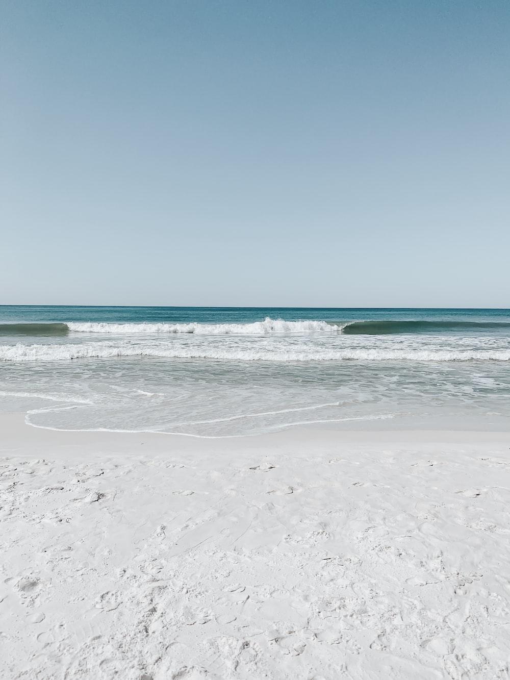white sand beach under clear blue sky